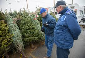 Fred DeVictor Left And Don Sheriff Both With Lawrence Breakfast Optimists Club Set Up The Clubs Christmas Tree Stand In Parking Lot Of Hy Vee On