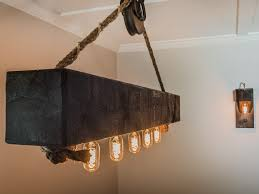 rustic wood beam chandelier with edison bulbs and pulley