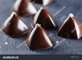 luxury pyramid shaped chocolate candy on stock photo 709954336
