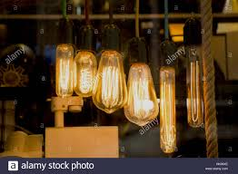 decorative antique edison style filament light bulbs hanging stock