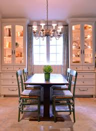 Farmhouse Dining Room White Built In Corner Cabinets With Warm Lighted Inner Space Silver Draperies Classic