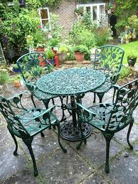 Cast Metal Aluminium Garden Patio Round Green 80cm Table + 4 Carver Chairs Brompton Metal Garden Rectangular Set Fniture Compare 56 Bistro Black Wrought Iron Cafe Table And Chairs Pana Outdoors With 2 Pcs Cast Alinium Tulip White Vintage Patio Ding Buy Tables Chairsmetal Gardenfniture Italian Terrace Fniture Archives John Lewis Partners Ala Mesh 6seater And Bronze Home Hartman Outdoor Products Uk Our Pick Of The Best Ideal Royal River Oak 7piece Padded Sling Darwin Metal 6 Seat Garden Ding Set