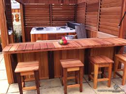 Wooden Patio Bar Ideas by Inexpensive Diy Outdoor Tub Enclosure With Bar And Louvered