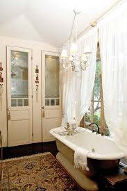 Chandelier Over Bathtub Soaking Tub by White Clawfoot Soaking Tub With Stainless Steel Mixer Faucet On