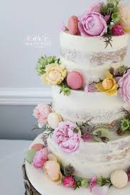 Floral Semi Naked Wedding Cake With Fresh Flowers And Macarons In Bright Colours At Durker