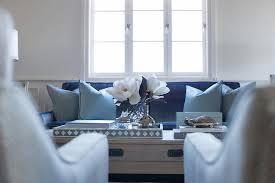 Dark Blue Velvet Sofa With Light Pillows