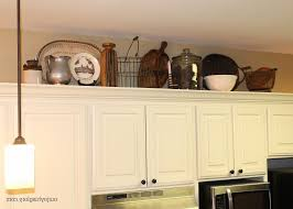 Christmas Decorating Above Cabinets Brown White Wooden