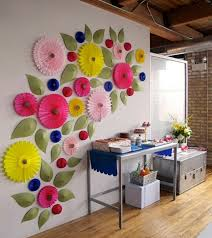 Paper Fans And Leaves Make An Impressive Temporary Wall Decoration For A Themed Party