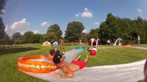 Backyard Blowout: Tips For Throwing The Hottest... More Accurate Names For The Slip N Slide Huffpost N Kicker Ramp Fun Youtube Triyaecom Huge Backyard Various Design Inspiration Shaving Cream And Lehigh Valley Family Just Shy Of A Y Pool Turned Slip Slide Backyard Racing With Giant 2010 Hd Free Images Villa Vacation Amusement Park Swimming 25 Unique Ideas On Pinterest In My Kids Cided To Set Up Rebrncom Crazy Backyard Slip Slide