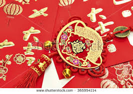 Assorted Chinese New Year Decorations On Red Background FU Mean Good Luck