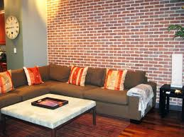 Brown Sectional Living Room Ideas by Living Room Brick Wall On One Side Brown Sectional Sofa Orange