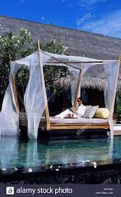 100 One And Only Reethi Rah Maldives North Mal Atoll Hotel Girl Stock
