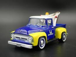 100 Used Tow Trucks 1956 56 FORD F100 TOW TRUCK MICHELIN RARE 164 SCALE DIORAMA DIECAST MODEL CAR