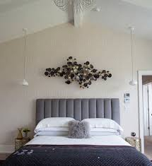 Master Bedroom Wall Decor Above Bed Over The Art Headboard Round Bedside Tables On Brown