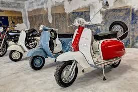 Download Vintage Scooters Lambretta And Vespa Editorial Stock Photo