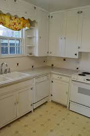 1940s White Kitchen Upon Closer Inspection There Are A Few Issues Though Like This Cabinet Its So Close To The Dishwasher That It Actually Doesnt