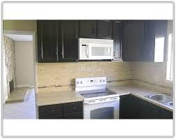 espresso kitchen cabinets with white appliances home design ideas