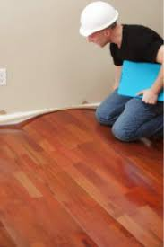 Wood Floor Cupping In Kitchen by Why Floating Floors Fail Flooring Contractors Flooring Stores