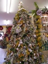 Fortunoff Christmas Trees 2013 by Blue Christmas Tree I Like The Poinsettias And Mesh Ornament