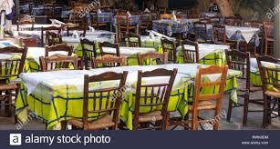 Greek Typical Outdoors Tavern, Empty Tables And Chairs ... Tables Old Barrels Stock Photo Image Of Harvesting Outdoor Chairs Typical Outdoor Greek Tavern Stock Photo Edit Athens Greece Empty And At Pub Ding Table Bar Room White Height Sets High Betty 3piece Rustic Brown Set Glass Black Kitchen Small Appealing Swivel Awesome Modern Counter Chair Best Design Restaurant Red Checkered Tisdecke Plaka District Tavern Image Crete Greece Food Orange Wooden Chairs And Tables With Purple Tablecloths In