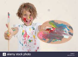 Boy Painting With Brush And Paint Pallet