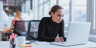 woman focused on puter at work