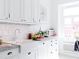kitchen with white tiles kitchen and decor