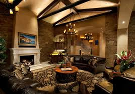Stone Accent Wall Family Room Mediterranean With Black Leather Sectional Beige Fireplace