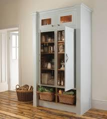 grey wooden standing corner pantry cabinet with double door and