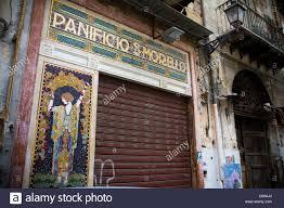 beautiful vintage bakery shop facade and front door in palermo