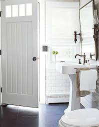 bathrooms white pedestal sink white subway tiles backsplash