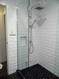 shower tile accent strips white with light grey grout floor tiles