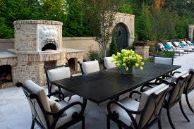dark wood oven with wood patio furniture patio mediterranean and
