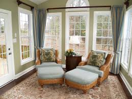 Sunroom Furniture Ideas With Rattan Wicker Chairs Round Wooden Table On Floral Rug Under White
