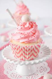 These Strawberry Milkshake Cupcakes have a vanilla malt base and are topped with a strawberry milk