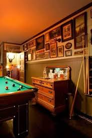 Game Room House With Wainscoting And Framed Wall Photos : Good ... Great Room Ideas Small Game Design Decorating 20 Incredible Video Gaming Room Designs Game Modern Design With Pool Table And Standing Bar Luxury Excellent Chandelier Wooden Stunning Fun Home Games Pictures Interior Ideas Awesome Good Combing Work Play Amazing Images Best Idea Home Bars Designs Intended For Your Xdmagazinet And Rooms Build Own House Man Cave 50 Setup Of A Gamers Guide Traditional Rustic For