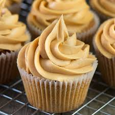 A Close Up Of Caramel Cupcake Topped With Swirl Buttercream More