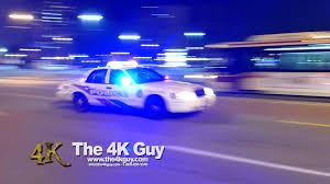 Toronto Police cars flying by with lights & sirens 11 10 2015
