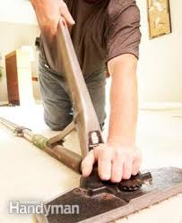 How Does A Carpet Stretcher Work by How To Repair Carpet Removing Wrinkles Family Handyman