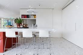 Clean Crisp White Modern Kitchen Island Bench With High Chairs..