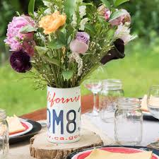 Rustic Vintage Flower Centerpiece For Weddings Showers Birthdays And Parties A Repurposed License Plate Is Used As Vase Your Arrangement