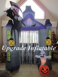 Inflatable Halloween Cat Archway by Large Halloween Inflatable Spider In Yard With Snow Stock Photo