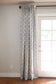 sew curtains using drapery hooks hung on an industrial rod grey