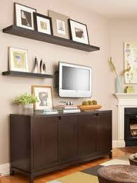 Gallery Wall With TV Console Floating Shelves
