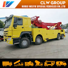 100 Tow Truck In Spanish Hot Item Sinotruk HOWO Car Carrier Wrecker Recovery Lorry 40mt 360 Degree Heavy Duty Rotator