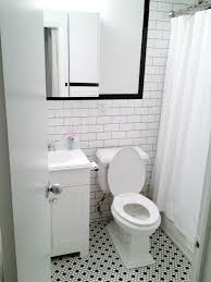 white subway wall tiles with black grout black bullnose floor