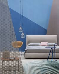 a stunning master bedroom design in blue and grey with a mid