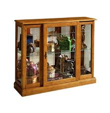 Pulaski Glass Panel Display Cabinet by Console Curio Cabinet In Golden Oak Iii By Pulaski Home Gallery