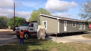 Crane Mobile Home Transport delivers a home