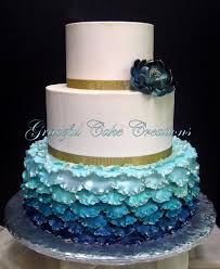 Elegant Peacock Inspired Ruffled Ombre Wedding Cake accent…